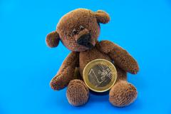 Stock Photo of teddy bear and euro coins
