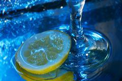 glass of wine and lemon - stock photo