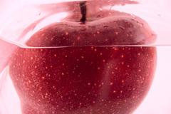 Red apple in the water Stock Photos