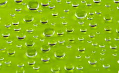 Drops of water on a colorful background Stock Photos