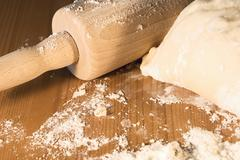 rolling pin and flour - stock photo
