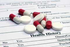 health history and pills - stock photo