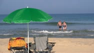 Adult couple exiting the sea Stock Footage
