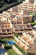 Sunny apartment block on spanish urbanisation - stock photo
