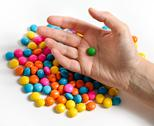 Candy with hand Stock Photos