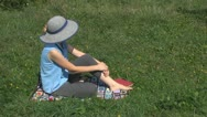 Beautiful woman playing with her dog fun entertainment sitting love pasture gard Stock Footage