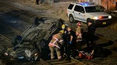 Car Upside Down on Train Tracks Stock Footage