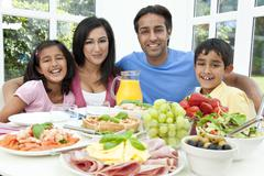 Asian indian parents children family eating healthy food Stock Photos