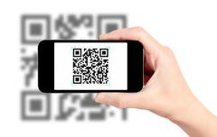 hand holding mobile phone with qr code scanner - stock illustration