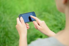 using mobile phone - stock photo