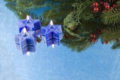 blue star candles and fir branch - stock photo