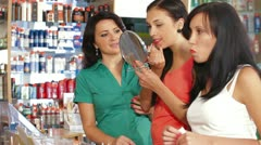 Testing Lipstick in Cosmetics Store Stock Footage