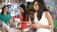 Women Testing and Buying Cosmetics Stock Footage