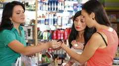 Women Shopping for Cosmetics Stock Footage