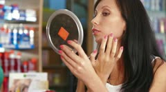 Woman Shopping for Beauty Care Products Stock Footage
