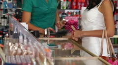 Woman Paying For Beauty Care Products Stock Footage