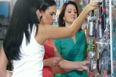 Young Women Shopping in Cosmetics Store Stock Footage
