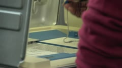 Voting, close up of hands punching ballot - stock footage
