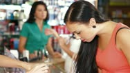 Girl Shopping in Cosmetics Store Stock Footage