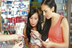 Women Shopping for Cosmetics in Beauty Department Stock Footage