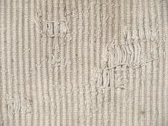 The rough dirty knit fabric texture. Stock Photos