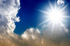 Bright sun and clouds Stock Illustration