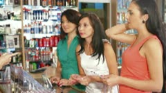 Sales Person Assisting Female Shoppers in Choice of Cosmetics - stock footage