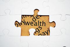 wealth puzzle concept - stock photo