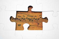Musiikki puzzle käsite Kuvituskuvat