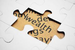 Wealth puzzle concept Stock Photos