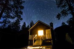 Cabin in the Wood and Night Stars Milkway - stock photo