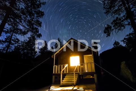 Stock photo of Cabin in the Wood and Night Stars Milkway