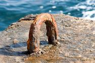 Rusty iron attachment in dock Stock Photos