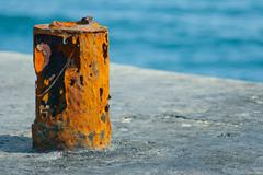 Old rusty attachment in port Stock Photos