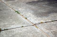 Intersecting lines in cement Stock Photos
