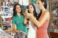 Choosing Tone of Hair Dye in Beauty Department Stock Footage