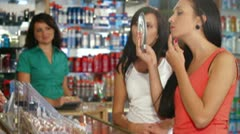 Female Customers Testing Makeup Foundation Stock Footage