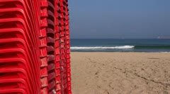 Red chairs on beautiful beach Stock Footage