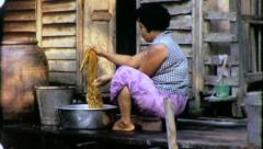 Woman WASHING LAUNDRY Riverside Thailand 1970s Vintage Film Home Movie 4222 Stock Footage