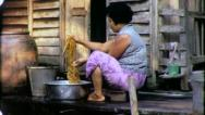 Stock Video Footage of WASHING LAUNDRY Riverside Bangkok Circa 1970 (Vintage Film Home Movie) 4222