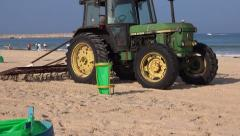 Tractor cleaning  the beach Stock Footage