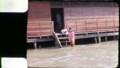 WASHING LAUNDRY Riverside Bangkok Thailand 1970 (Vintage Film Home Movie) 4265 Stock Footage
