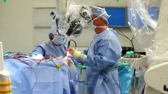 Wide shot of surgeon doing brain surgery - stock footage