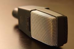 Retro Studio Microphone on Dark Table Top - stock photo