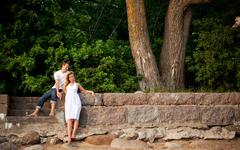Couple stand next stonewall in forest Stock Photos