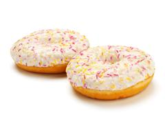 two sugar glazed donuts - stock photo