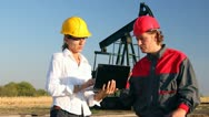 Workers in an Oilfield, teamwork Stock Footage