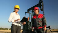 Workers in an Oilfield, teamwork Stock Footage