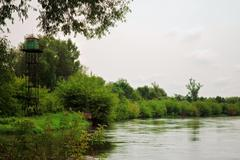 Calm river with watchtower Stock Photos