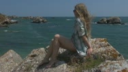 Beautiful woman relaxing on the beach, coastline lady girl young sea ocean wave Stock Footage